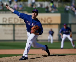 Texas Rangers pitcher Alex Gonzalez pitches in the eighth inning during a Major League Baseball spring training game against the Kansas City Royals at Surprise Stadium in Surprise, Arizona Wednesday March 4, 2015. The Royals beat the Rangers 13-2. (Andy Jacobsohn/The Dallas Morning News) 03102015xSPORTS